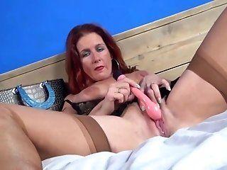 Fingering,Masturbation,Redhead,Mature,Dildos/Toys A mature gal...